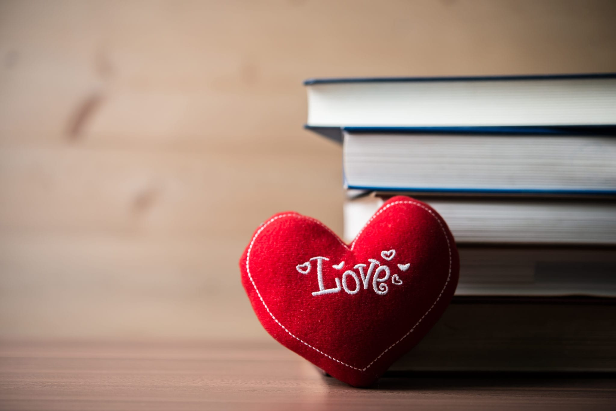Red Heart And Book On Wooden Table. For Love Or Valentine Day Co