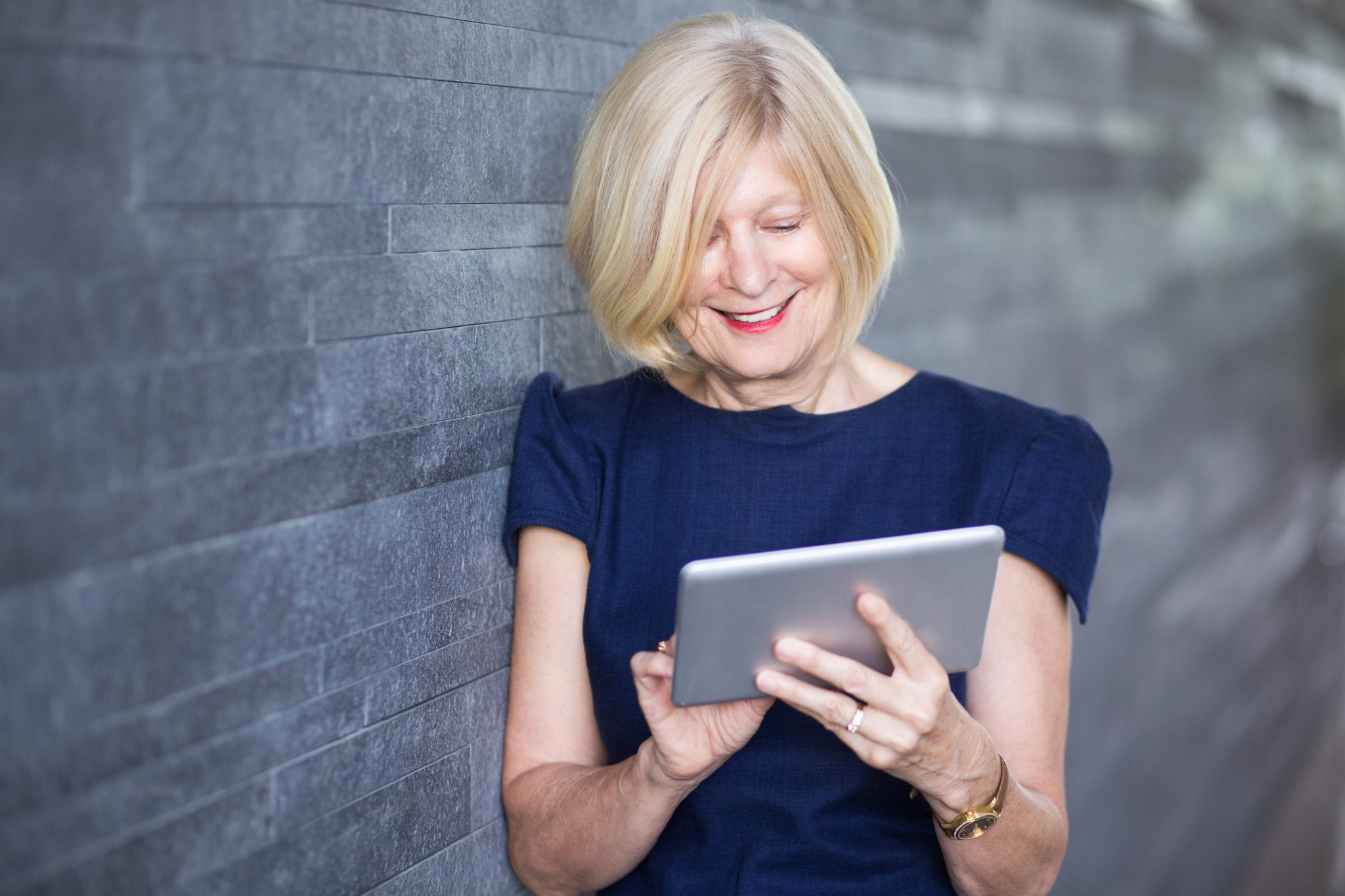 Happy Senior Businesswoman Using Digital Tablet